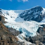 The Columbia Icefields feeds a glacier sliding down a mountain.